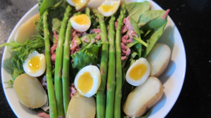 Jersey royals, ham hock, asparagus and quail's egg salad